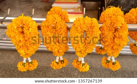 Beautiful Yellow Marigold Wreaths or Garlands, The Garland in Thai Tradition Style Used to Pay Respect to The Buddha. #1357267139