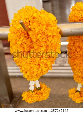 Beautiful Yellow Marigold Wreaths or Garlands, The Garland in Thai Tradition Style Used to Pay Respect to The Buddha. #1357267142