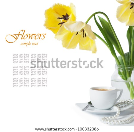 beautiful yellow tulips and a cup of coffee on a white background