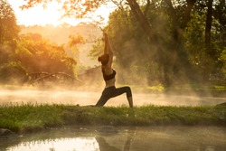 Beautiful Yoga woman in the morning at the hot spring park, soft and select focus