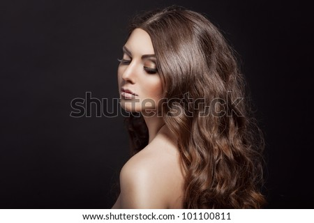 Beautiful young adult girl with long curly beauty hair posing