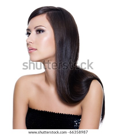 Beautiful young adult girl with long straight beauty hair posing isolated on white background