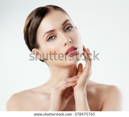 Shutterstock Beautiful  young adult woman with clean fresh skin.