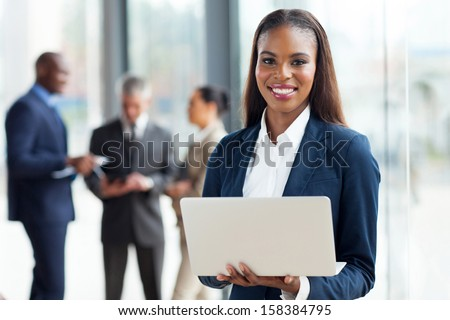 beautiful young african american businesswoman using laptop computer in office