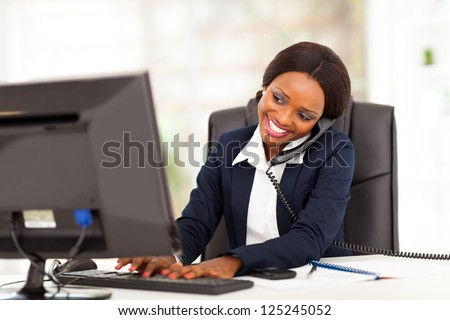 beautiful young african american businesswoman working in office - stock photo