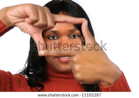 Beautiful young African American woman creating a frame with her fingers