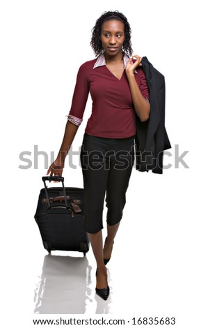 Beautiful young African-American woman pulls a suitcase