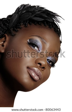 beautiful young African woman portrait wearing feather headband and dark smoky eyeshadow over white background