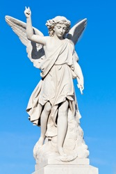 Beautiful young angel statue with a clear sky background
