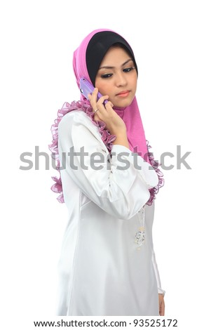 Beautiful young asian muslim woman talk on mobile phone isolated white background