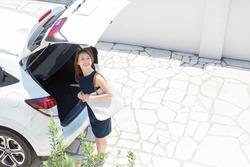 Beautiful young asian woman and car