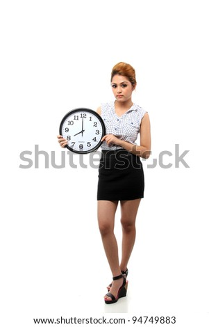 Beautiful young asian woman hold a clock show time at eight o clock isolated on white