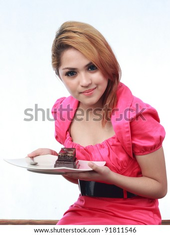 Beautiful young asian woman holding cake isolated white background