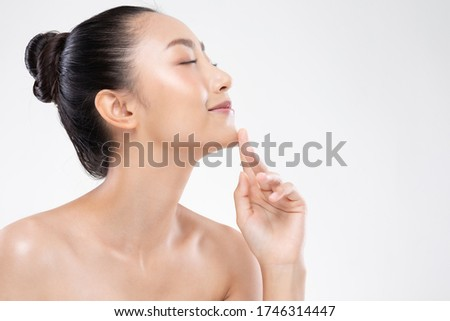 Beautiful Young Asian Woman Looking While Touching Chin feeling so happy and cheerful with healthy Clean and Fresh skin on white ,Plastic Surgery chin,Beauty Cosmetics and spa facial treatment Concept