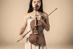 beautiful young asian woman playing violin