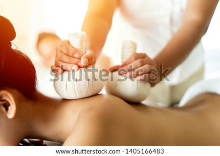 Beautiful young Asian woman relaxing during full body massage at spa environment, Leisure. lifestyle beauty woman concept