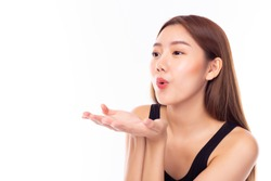 Beautiful young asian woman sending and blowing air kiss over isolated on white background. demonstrates her good feeling, says goodbye on distance. Young pretty female make air kiss. Copy space