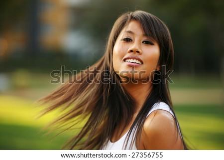 Beautiful young asian woman waving her hair. Shallow DOF