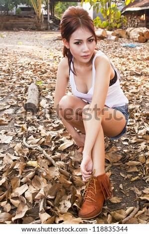 Beautiful young Asian woman wearing blue short jean