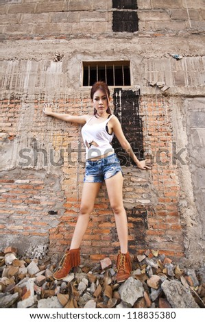 Beautiful young Asian woman wearing blue short jean