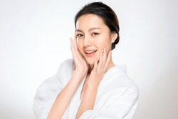Beautiful Young asian Woman with Clean Fresh Skin look. Girl beauty face care. Facial treatment. Cosmetology, beauty and spa.