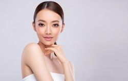 Beautiful young asian woman with Clean Fresh Skin on face . Chinese girl Facial  treatment . Cosmetology , beauty  and spa .