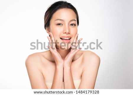 Beautiful Young Asian Woman with Clean Fresh Skin touch own face, Facial treatment, Cosmetology, beauty and spa,