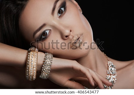 Beautiful young asian woman with elegant earrings and necklace
