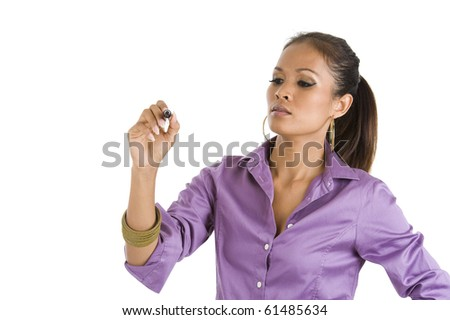 beautiful young asian woman writing whatever you want with a black marker, isolated on white background