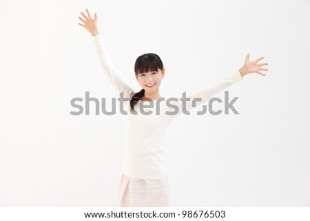 Beautiful young Asian women raise their hands in white background