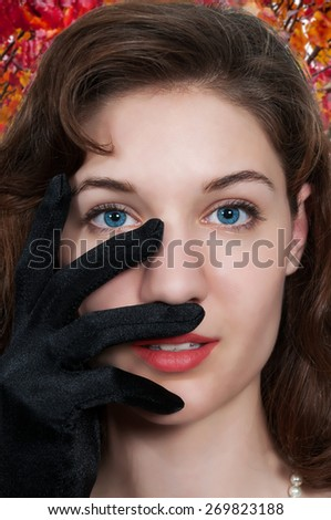 Beautiful young attractive high society woman wearing formal opera gloves