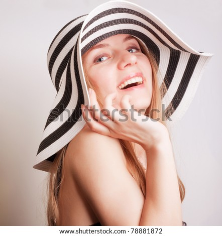 beautiful young attractive woman posing in a summer hat