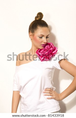 Beautiful young beautiful female with pompon t-shirt