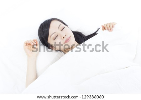 beautiful young beautiful woman sleeping on the bed, isolated on white background