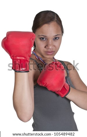 Beautiful young black African American woman wearing a pair of boxing gloves