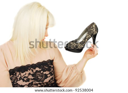 Beautiful  young  blond lady dreams about woman's shoes isolated on the white .
