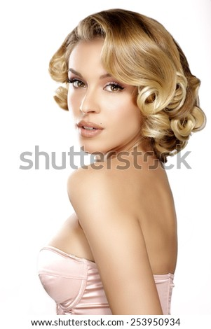 Beautiful young blond model curly hair posing on white