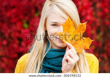 Beautiful young blond woman - colorful autumn portrait #306598532