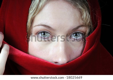 stock-photo-beautiful-young-blond-woman-in-closeup-with-shawl-over-her-face-18025669.jpg