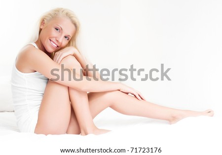 beautiful young blond woman on the bed at home
