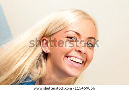beautiful young blonde girl smiling posing for photos