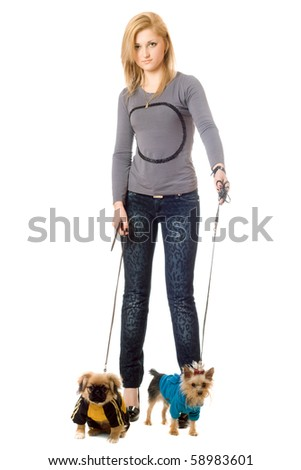 Beautiful young blonde posing with two dogs. Isolated