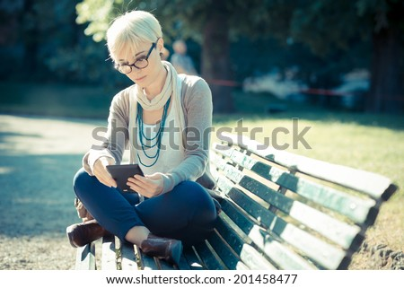 http://image.shutterstock.com/display_pic_with_logo/598642/201458477/stock-photo-beautiful-young-blonde-short-hair-hipster-woman-using-tablet-in-the-city-201458477.jpg