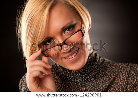 Beautiful young blonde with eyeglasses isolated