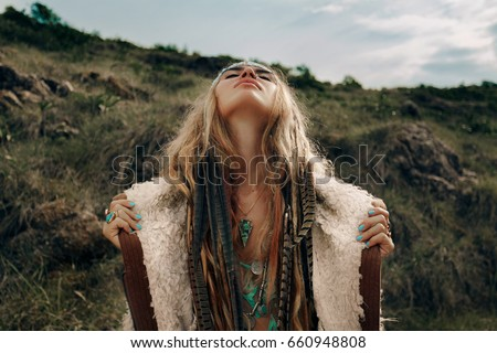 beautiful young boho girl in jacket look in the sky