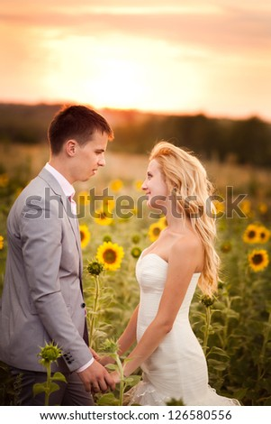 Beautiful young bride, in the wedding day with her beautiful groom