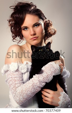 beautiful young bride with black cat