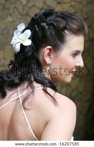 Beautiful young bride with flowers in her hair.