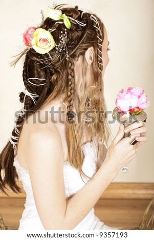 stock photo Beautiful young bride with long brown hair in wedding dress