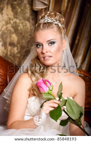 beautiful young bride with rose